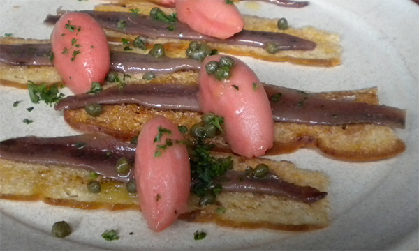 Anchovies on toast with smoked tomato sorbet